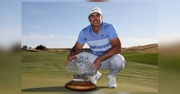 Brooks Koepka poses with the Phoenix Open trophy
